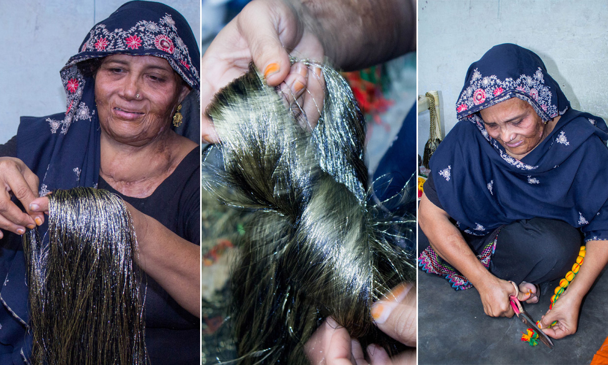Najma shows the different steps required to make a tassel. -Photo by Muhammad Umar