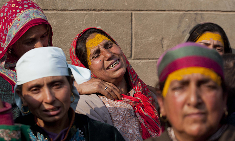 Shahmala grieves for her son Tariq Ahmad, a civilian killed in a gunbattle, at her residence In Nowbal village, south of Srinagar on Friday, Nov 14, 2014. — AP