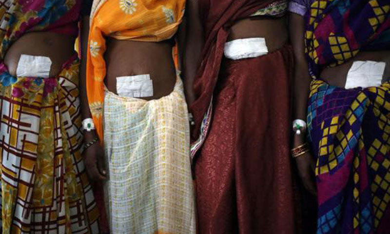 Women, who underwent sterilization surgery at a government mass sterilisation camp, pose for pictures inside a hospital at Bilaspur district in Chhattisgarh. — Reuters
