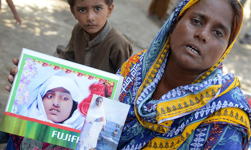 Razia Shaikh shows a photograph of her daughter. — AFP
