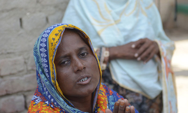 "Razia Shaikh, one of countless mothers to suffer the misery of ""karo kari"", gestures during an interview. — AFP"