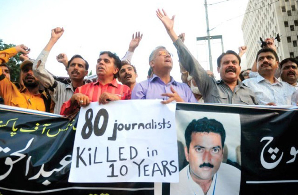 Journalists shout slogans during a demonstration protesting the killing of a television reporter in Khuzdar. — AFP