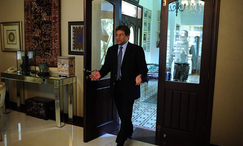 In this photograph taken November 14, 2014, Pakistan's former military ruler General (retd) Pervez Musharraf gestures as he arrives for an interview with AFP in Karachi. - AFP