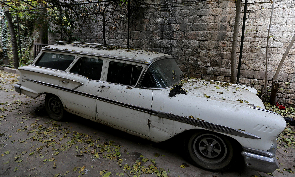 An old car belonging to Armen Mazloumian, the owner of the Baron Hotel is parked outside the lodge. —AFP
