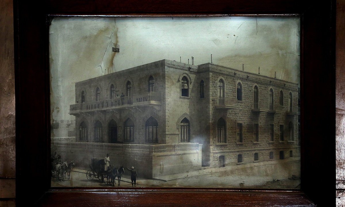 An old photograph of the Baron Hotel displayed inside the hotel. —AFP