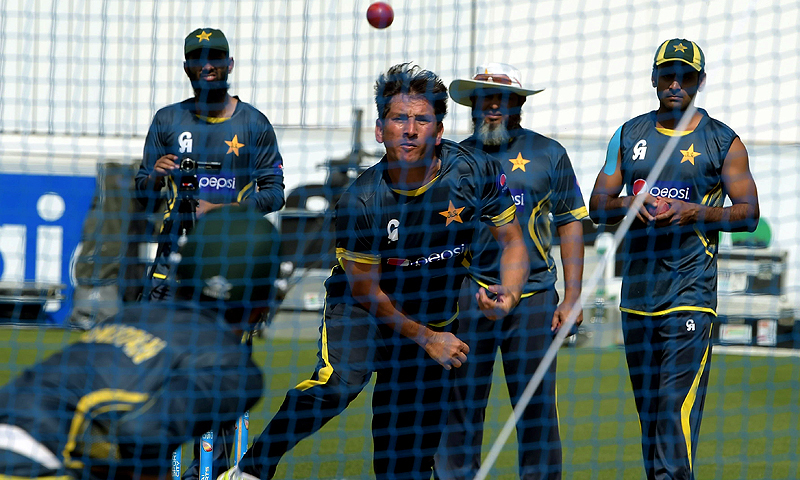 Yasir Shah bowls in the nets under the watchful eye of leg-spin maestro Mushtaq Ahmed. —AFP