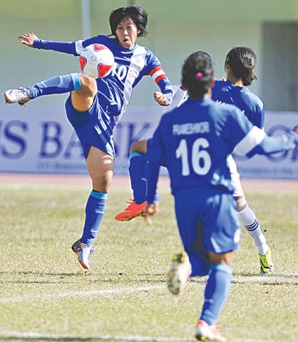 Indian captain Bala Devi kicks acrobatically during the semi-final against Sri Lanka. —White Star