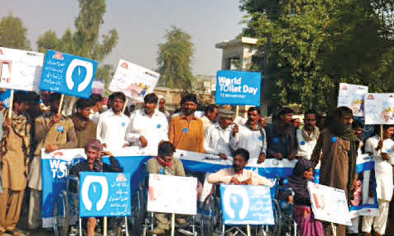 Special persons join a walk to mark the World Toilet Day in Muzaffargarh. — Dawn