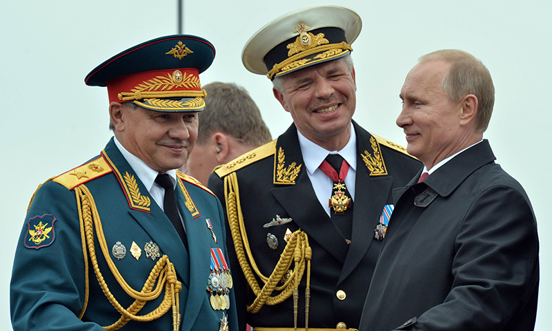 This picture shows Russian President Vladimir Putin, right, speaking with Defence Minister Sergei Shoigu, left, during his visit to the Crimean port of Sevastopol. — AFP/File