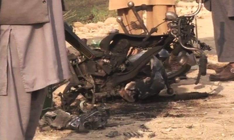 A view of a motorcycle mangled due to the explosion. - DawnNews screengrab