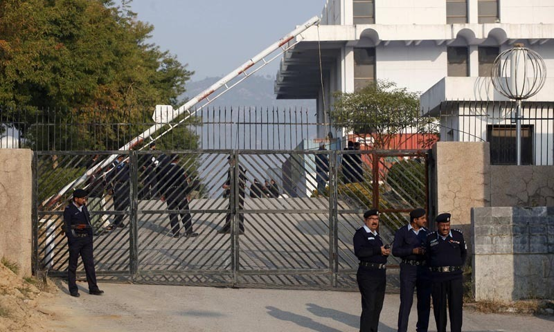 Police officers stand guard at the gate of the special court formed to try Pervez Musharraf for treason. — Reuters/File