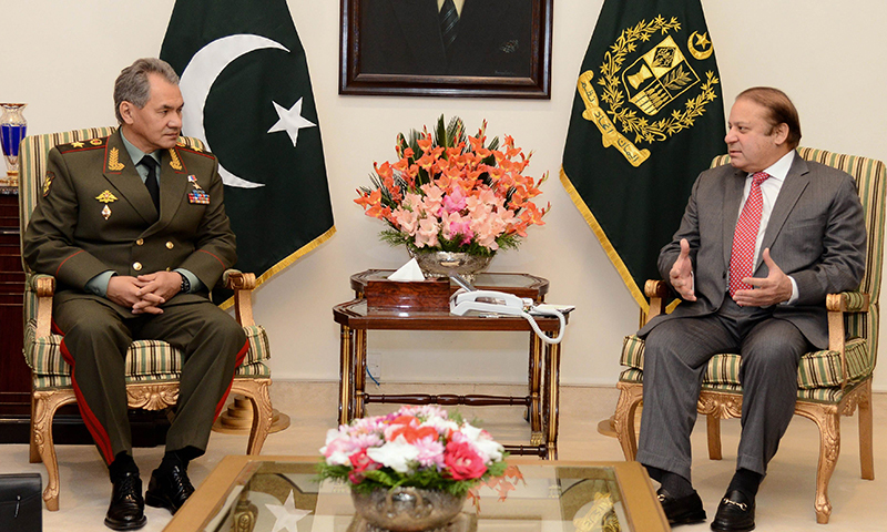 Photo from Nov 20, 2014, shows Prime Minister Nawaz Sharif (R) with Russian Defence Minister General Sergey Kuzhugetovich Shoy (L).—AFP