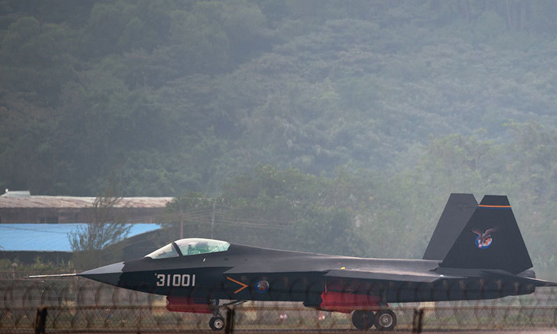 A Chinese J-31 stealth fighter taxis after a flight at the Airshow China 2014 in Zhuhai. — AFP