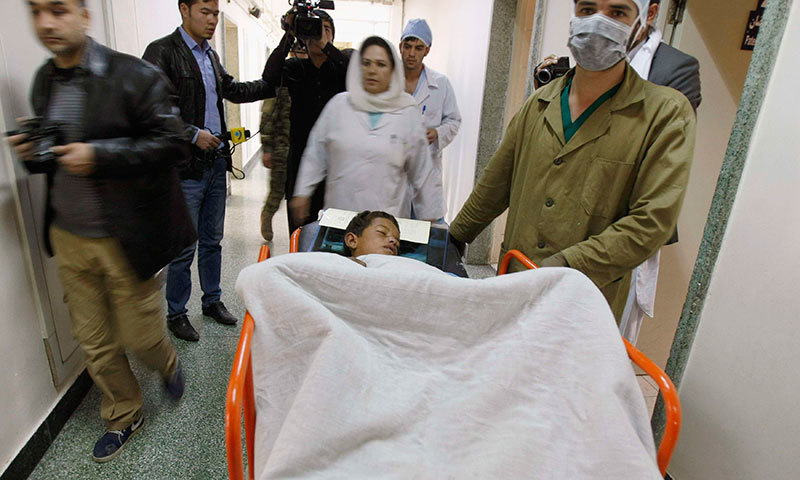 A boy receives treatment at a military hospital in Kabul, after being wounded during the suicide attack.—Reuters