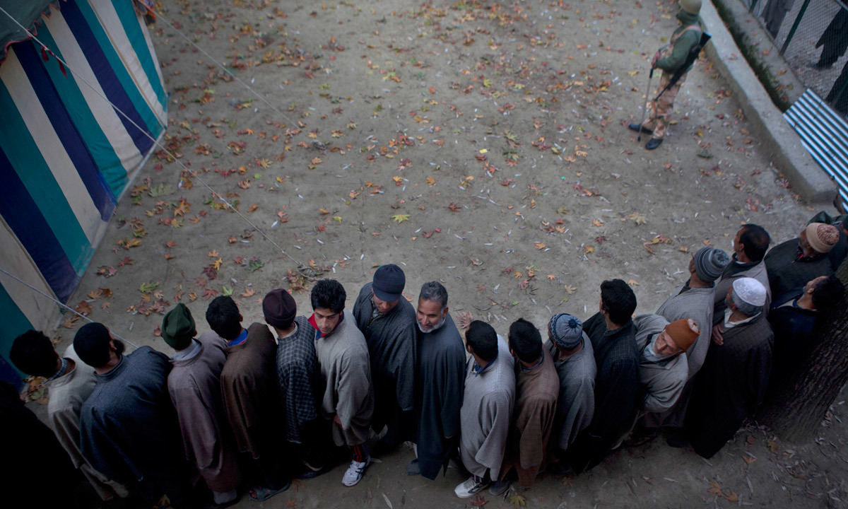 Kashmiri men line up to cast their votes.  — Photo by AP