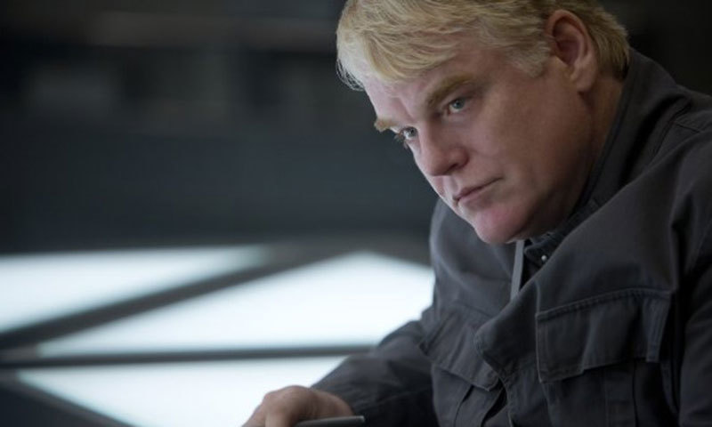The late Philip Seymour Hoffman as Plutarch Heavensbee. – Photo credit: IMDB