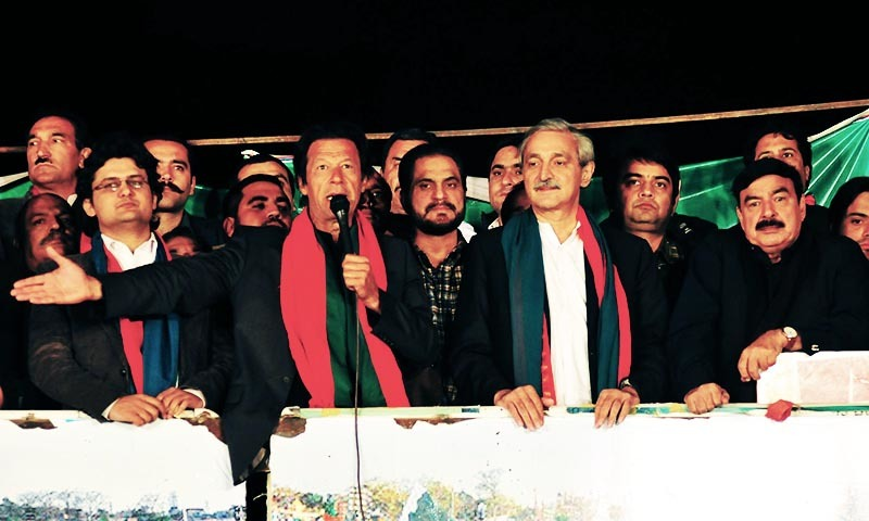 PTI chairman Imran Khan (2ndL first row) along with Jahangir Khan Tarin (2ndR first row) addressing his party's sit-in in Islamabad. - INP