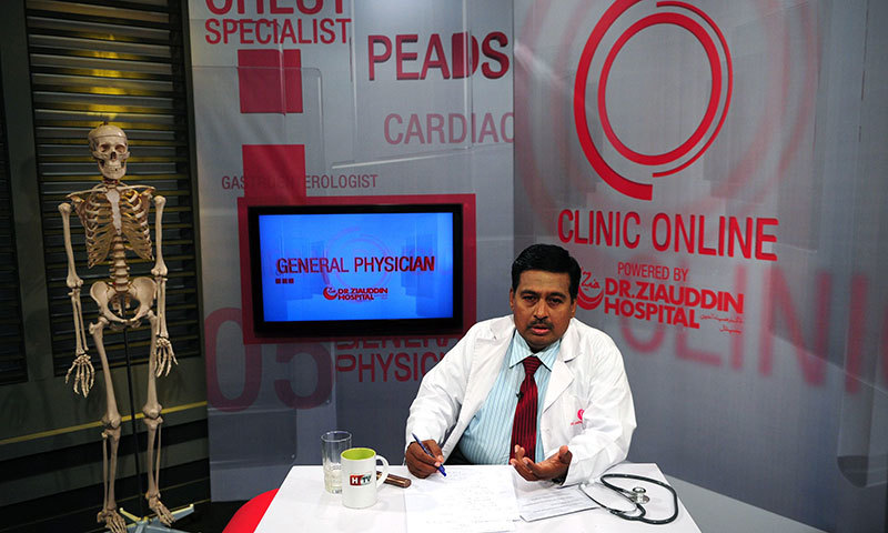 Doctor Nadim Uddin Siddiqui answers a question as he gives health tips on a Health TV show in Karachi. — AFP
