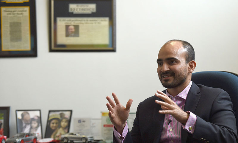 Faizan Syed Health TV director gestures as he gives an interview to AFP in Karachi. — AFP