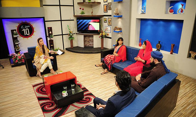Anoushey Ashraf (L), hosts a morning show on Health TV in Karachi. — AFP