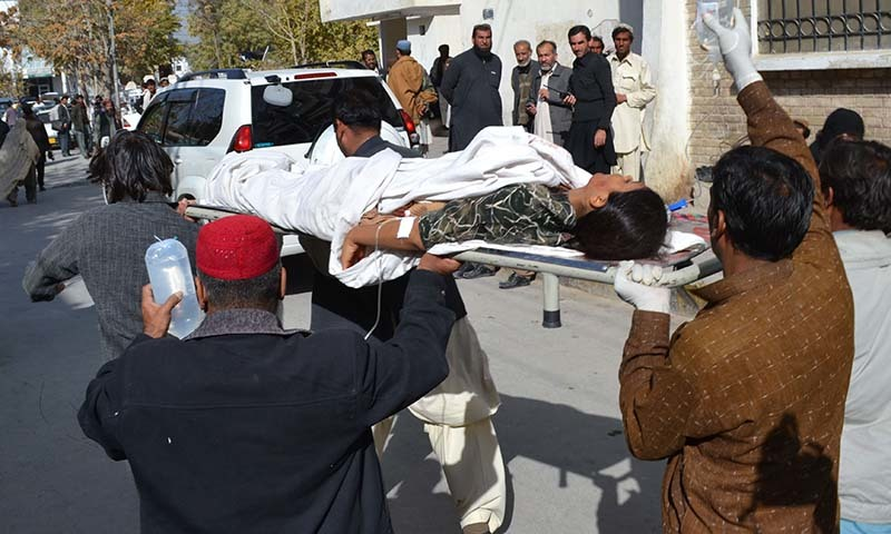 Volunteers shift an injured polio female health worker at a hospital in Quetta on November 26, 2014. - AFP