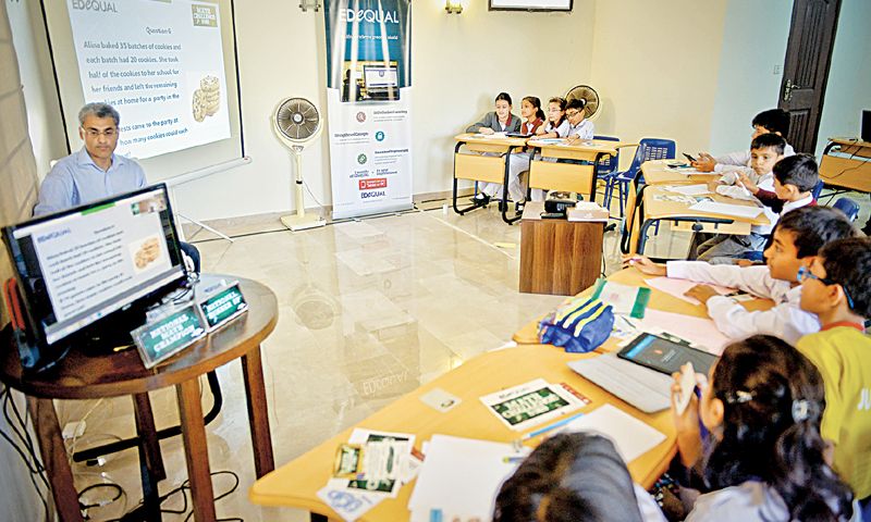 CONTESTANTS grapple with maths conundrums at the competition on Wednesday.—White Star