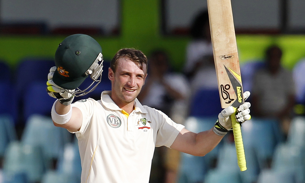 In this September 19, 2011 file photo, Australia's batsman Phillip Hughes celebrates after scoring a century during the fourth day's play of the third cricket test match between Australia and Sri Lanka in Colombo. Hughes died in a Sydney hospital on Thursday. — AP