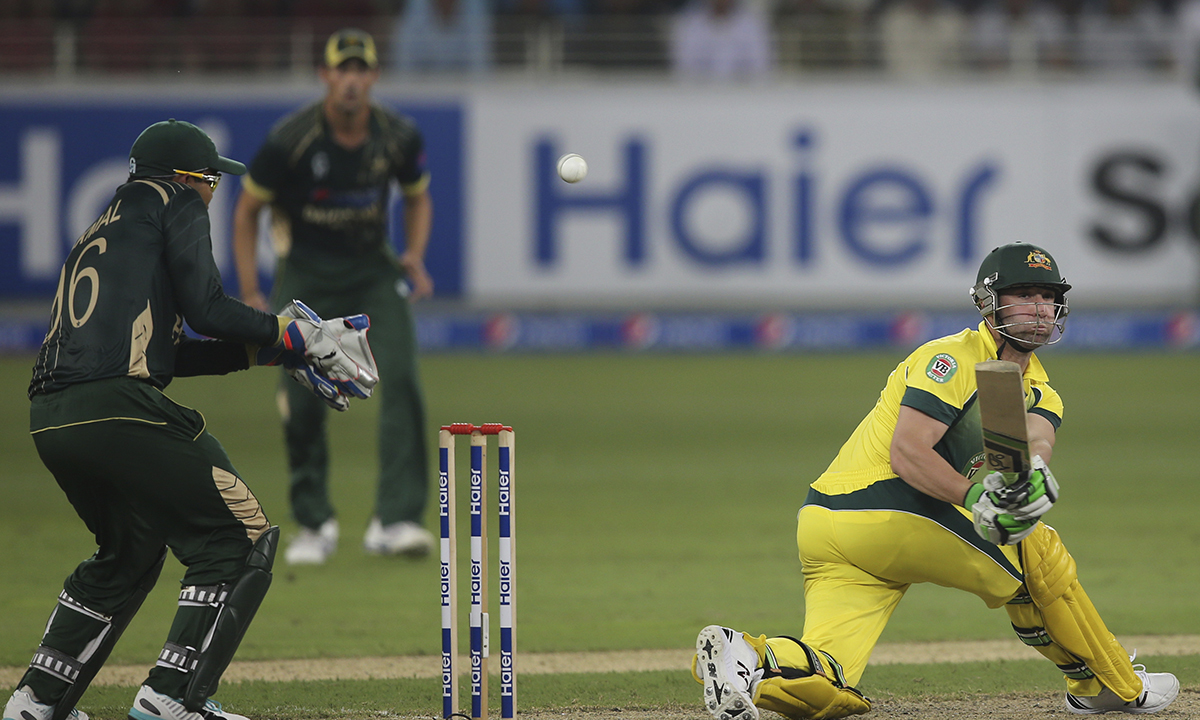 In this October 5, 2014 file photo, Australian batsman Phillip Hughes hits the ball during the first International T20 cricket match against Pakistan in Dubai, United Arab Emirates. — AP