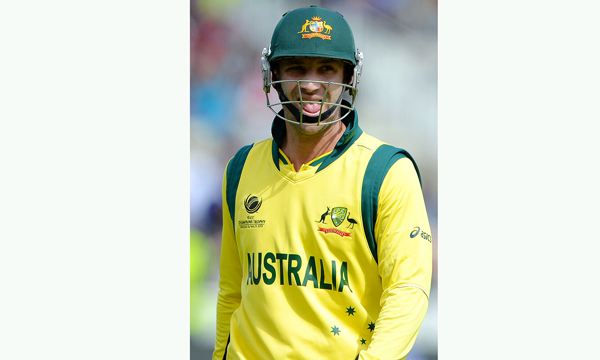 In this file picture taken on June 12, 2013, Australian batsman Phillip Hughes leaves the field after being run out during the 2013 ICC Champions Trophy One Day International (ODI) cricket match between Australia and New Zealand at Edgbaston in Birmingham, central England. —  AFP