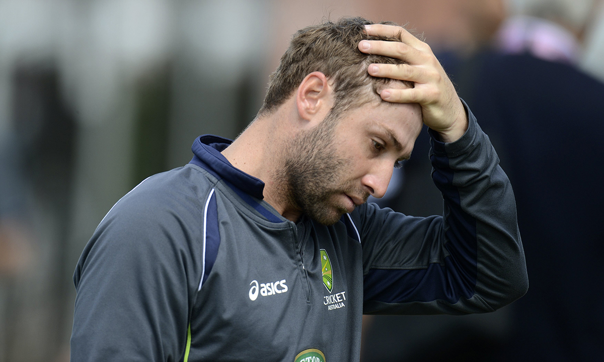 Australia's Phillip Hughes touches his head during a training session before the third Ashes cricket test match against England at Old Trafford cricket ground in Manchester on July 30, 2013. — Reuters