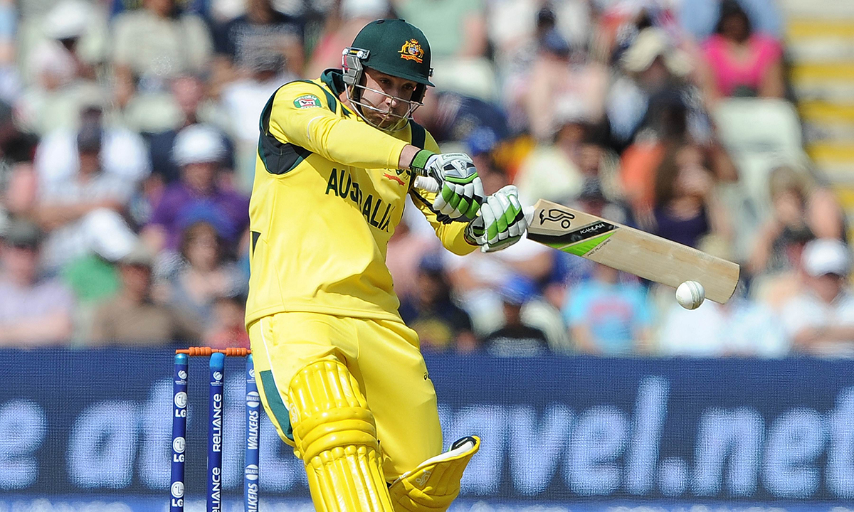 In this file picture taken on June 8, 2013, Australian batsman Phillip Hughes bats during the 2013 ICC Champions Trophy cricket match between England and Australia at Edgbaston in Birmingham, central England. — AFP