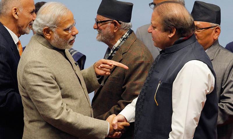 Indian Prime Minister Narendra Modi shakes hands with Prime Minister Nawaz Sharif during the closing session of 18th Saarc summit in Kathmandu. -Reuters Photo