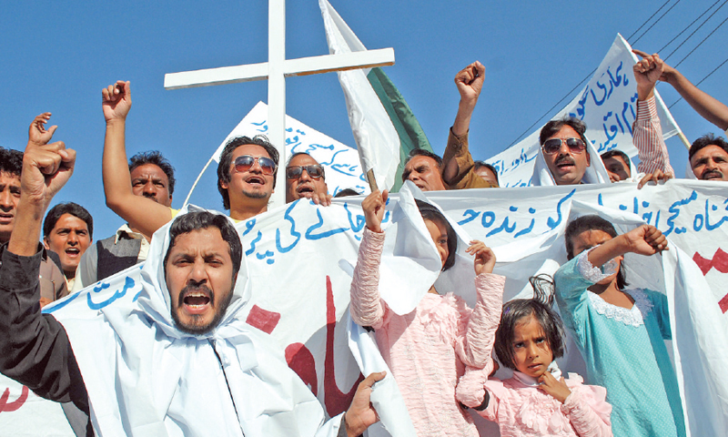 Members of Christian community stage a protest in Peshawar on Sunday, Nov 9, 2014 against killing of a couple in Kasur.—White Star