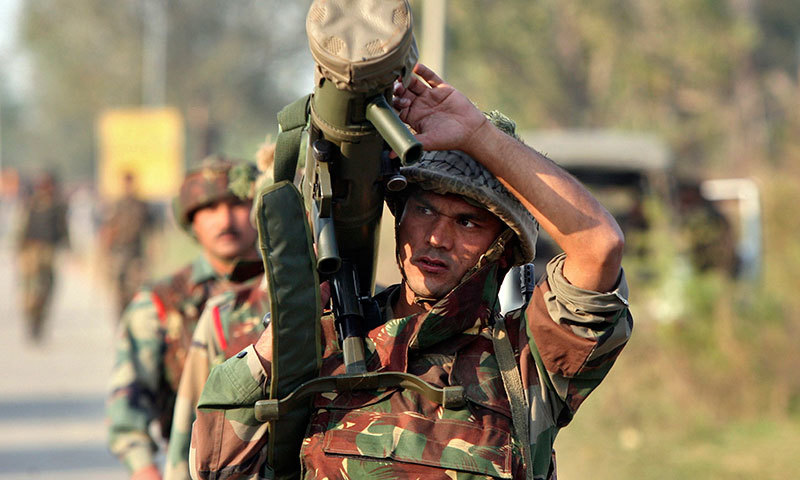 An Indian army soldier carries a rocket launcher near the site of a gunbattle with suspected militants at Pindi Khattar village in Arnia near the border with Pakistan. -Reuters Photo