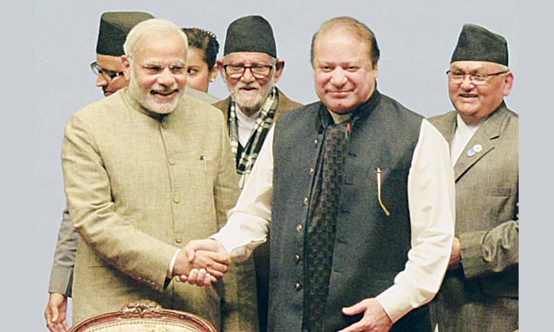 KATHMANDU: Prime Ministers Narendra Modi and Nawaz Sharif are all smiles as they shake hands at the concluding ceremony of the Saarc summit on Thursday.—Online