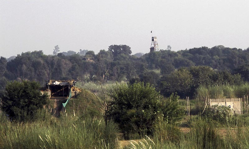 An Indian security picket (L) and a Pakistani security watch tower (R) are pictured along the border between India and Pakistan in the Samba sector. — Reuters/File