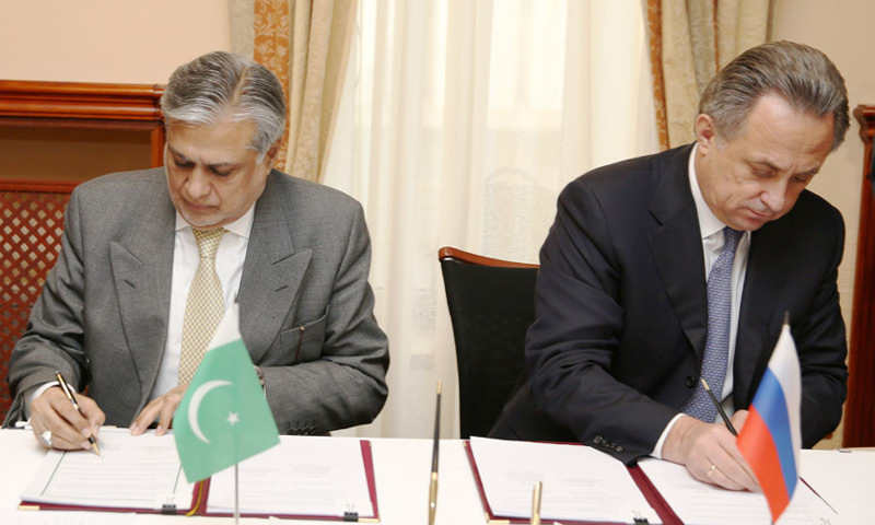 MOSCOW: Finance Minister Ishaq Dar and Russian minister V. Mutko sign the joint statement after the Pak-Russia Inter-Governmental Commission meeting on Friday.