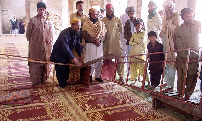 People gather at Madrassa Jamia Dar ul Uloom Haqqania after the killing of JUI-F Leader Dr Khalid Mahmood Soomro.—Photo by Online