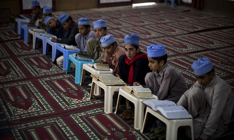 Students of a local madrassa, or Islamic school, recite verses of the Quran.   — AP/file