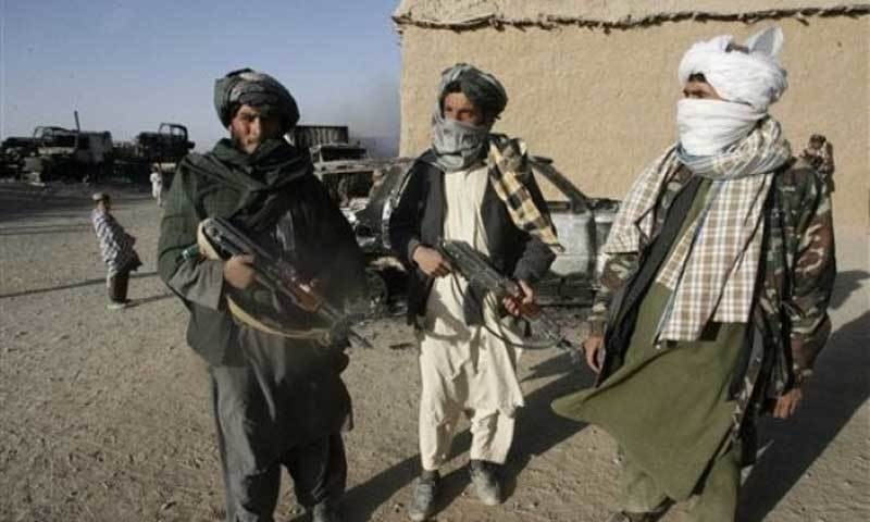 The image shows Afghan fighters. — AFP/File