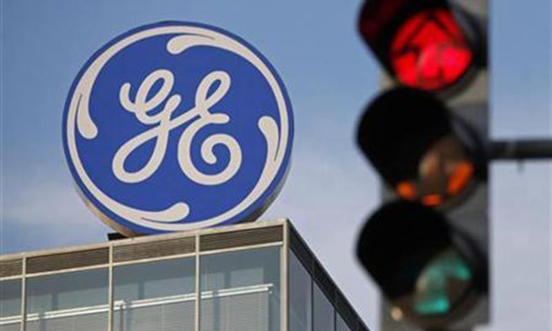 The logo of the GE Money Bank is seen behind a traffic light in Prague. — Reuters/File