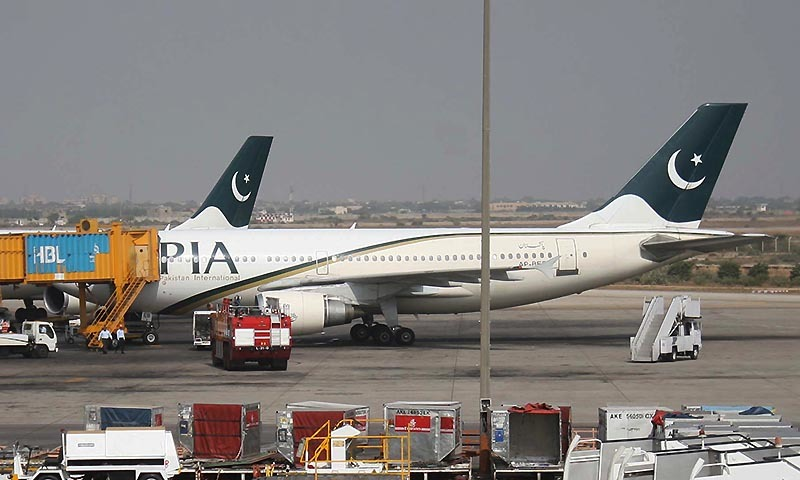 PIA aircraft standing on runway in Karachi. — PPI/file