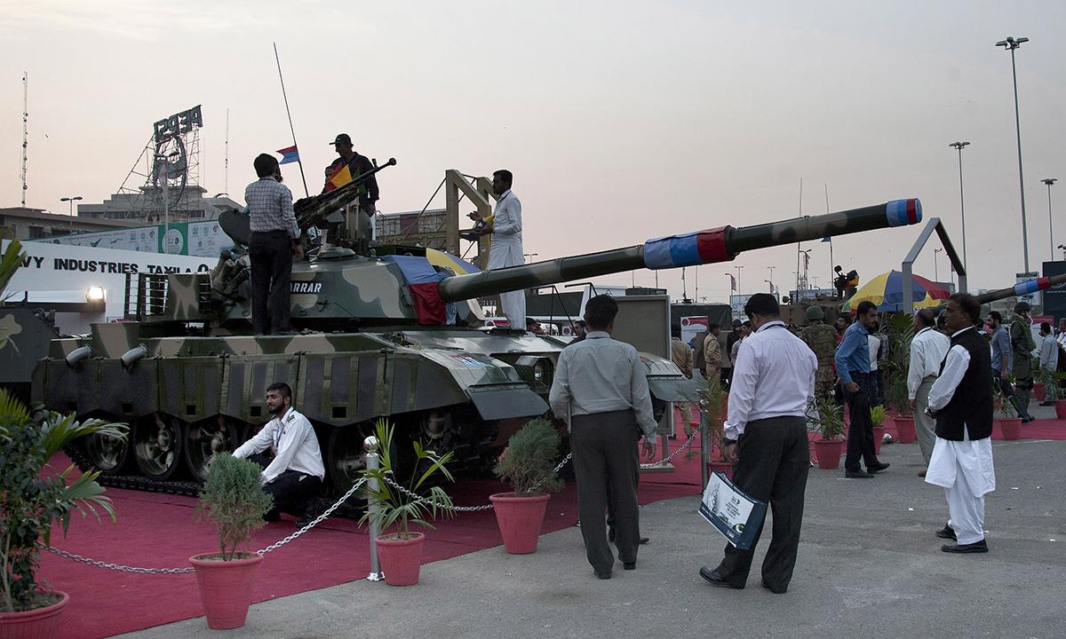 Pakistanis look at a tank displayed at Ideas. — AP