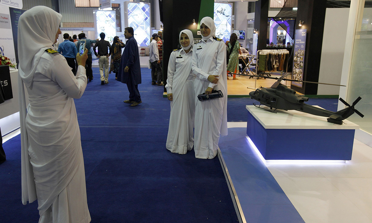 Pakistani women navy officers pose for photos.— Reuters