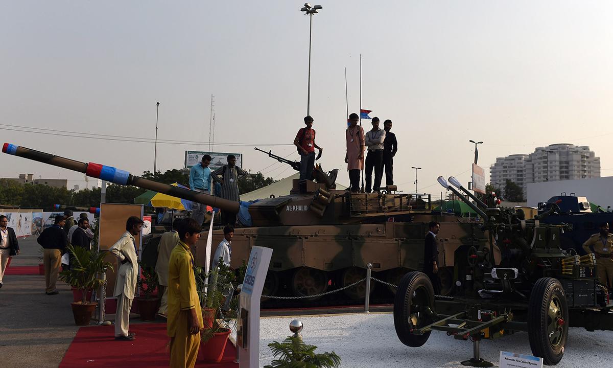 Visitors look at an Al-Khalid battle tank. — AFP