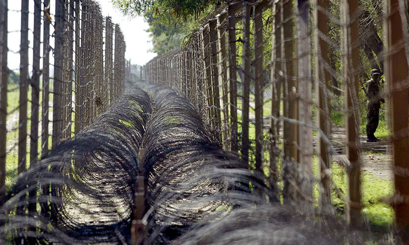In this photo, an Indian Border Security Force soldier patrols the India-Pakistan border area of Golpattan, about 35 kilometers west of Jammu. — AP/File