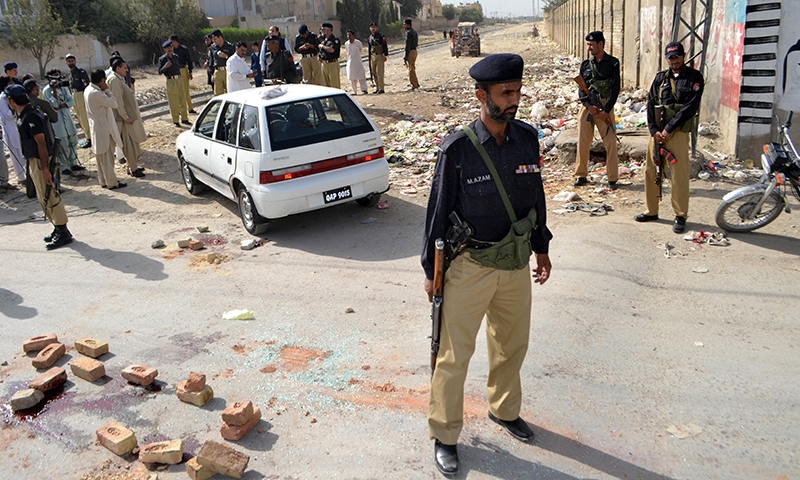This picture shows policemen stand on guard in Quetta. — AFP/File