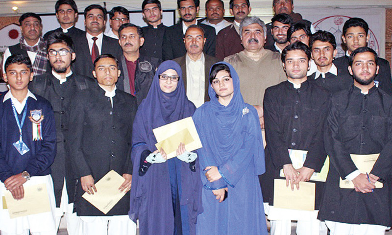 Winners of the speech competition with Prof Rafiullah, Abaseen Yousufzai and others at Khyber Union Hall, Islamia College Peshawar. — Dawn