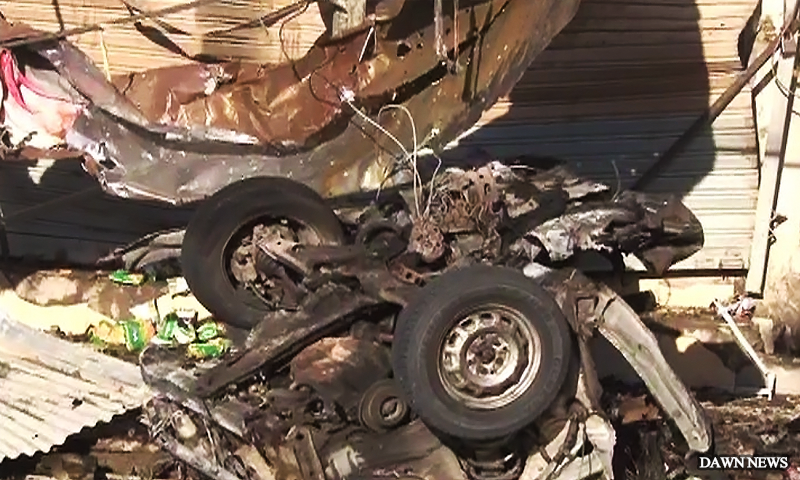 A view of a vehicle destroyed in the blast in Quetta.  — DawnNews screengrab