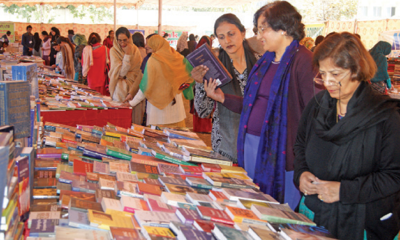 Students and faculty members sift through the books at a stall in Fatima Jinnah Women's University.